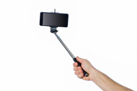 Man using a selfie stick shot in studio Stock Photo