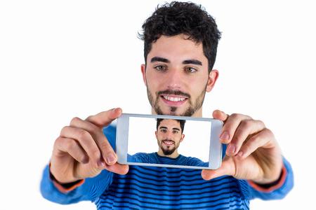 Casual man taking a selfie shot in studio Stock Photo