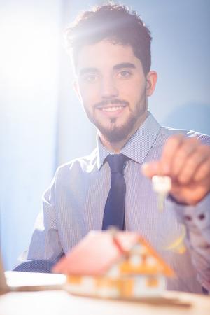classy house: Businessman showing a key shot in studio