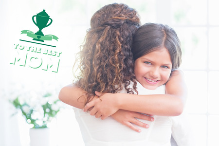 mothers day greeting against happy mother and daughter hugging photo