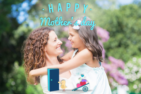 one parent: Chick with wheelbarrow of hearts against happy mother and daughter smiling at each other Stock Photo