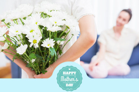 relationship mother and daughter: mothers day greeting against daughter giving mother white bouquet