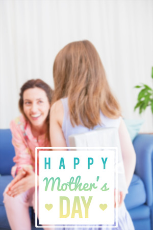 gift behind back: mothers day greeting against daughter surprising mother with gift