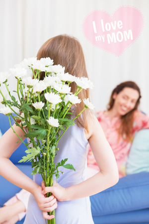 gift behind back: mothers day greeting against daughter surprising mother with flowers
