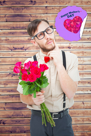 day dreaming: Geeky hipster offering bunch of roses against wooden planks background