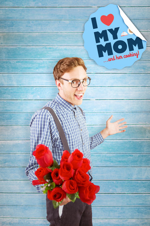 Geeky hipster holding a bunch of roses against wooden planks photo