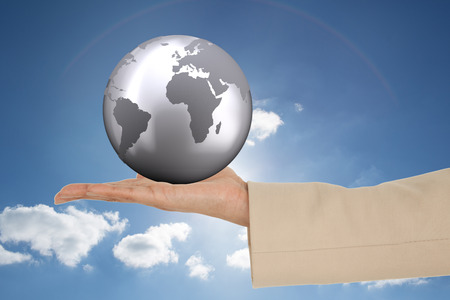 shiny suit: Female hand presenting against cloudy sky with sunshine Stock Photo