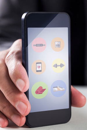 smartphone apps: Businessman using smartphone against fitness apps