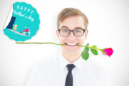 geeky: Geeky hipster holding a red rose in his teeth against chick with wheelbarrow of hearts