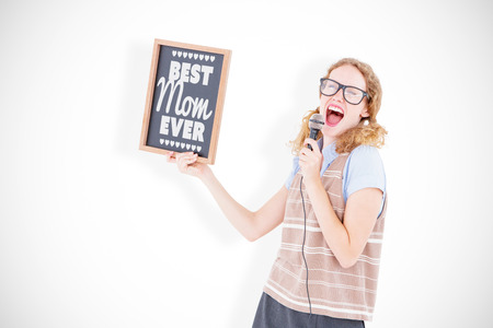 ever: Geeky hipster woman holding blackboard and singing into microphone against best mom ever