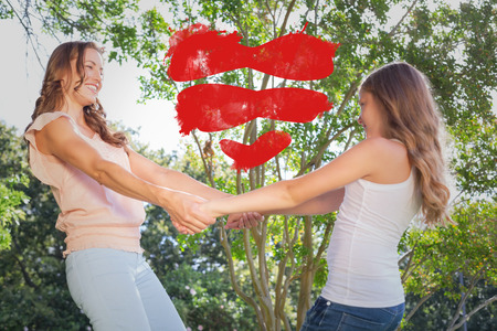 under heart: Heart against happy woman and girl holding hands under the tree