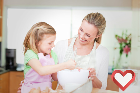 kitchen aprons: Mother and daughter having fun in the kitchen against heart Stock Photo