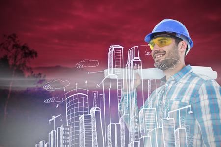engineer's: Smiling architect looking away while holding blueprint against trees and mountain range against cloudy sky Stock Photo