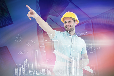 engineer's: Male architect with blueprints pointing away against skyscraper