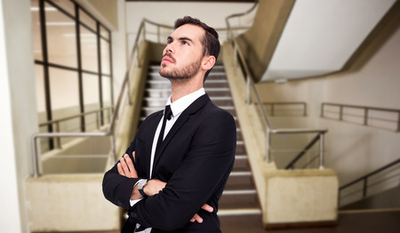 way of thinking: Thinking businessman with his arms crossed against empty stair way