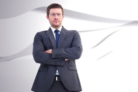 frowning: Frowning businessman looking at camera against white wave design