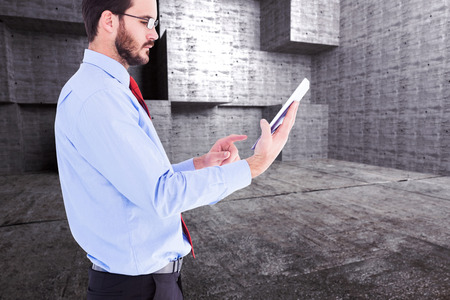 scrolling: Businessman scrolling on his digital tablet against abstract room