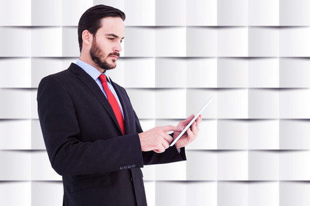 scrolling: Businessman scrolling on his digital tablet against abstract background