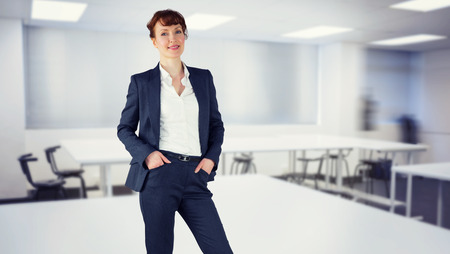 class room: Smiling businesswoman against empty class room