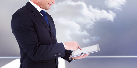 arms out: Mid section of a businessman with arms out against clouds in a room