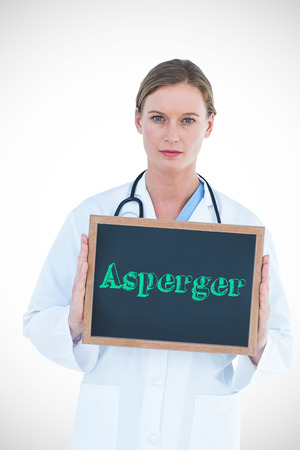 asperger: The word asperger against doctor showing chalkboard Stock Photo