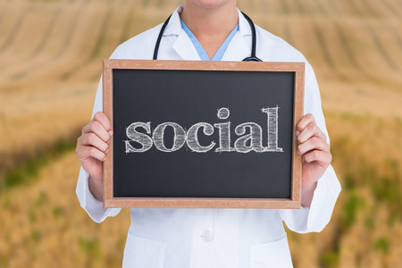 The word social and doctor showing little blackboard against rural fields photo