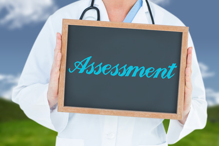 scrub grass: The word assessment and doctor showing chalkboard against field and sky Stock Photo