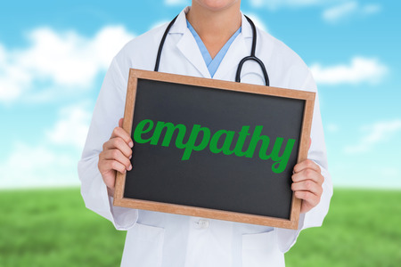 scrub grass: The word empathy and doctor showing little blackboard against field and sky Stock Photo