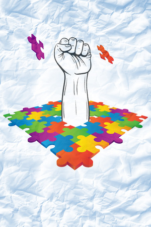 punching: Hand punching through jigsaw against crumpled white page Stock Photo