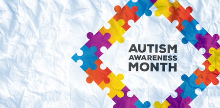 Autism awareness month against crumpled white page Stock Photo