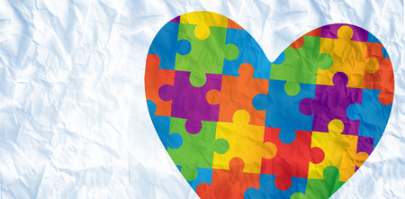 Autism awareness heart against crumpled white page