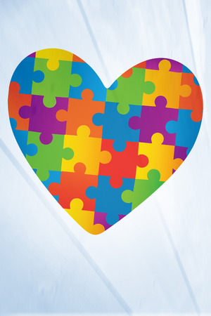 autism: Autism awareness heart against bleached wooden planks background Stock Photo