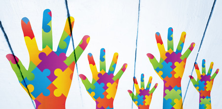 autism: Autism awareness hand against painted white wooden planks