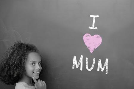 schoolchild: Mothers day greeting against schoolchild with blackboard