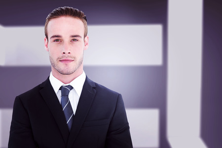 frowning: Frowning businessman looking at camera against abstract room