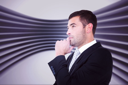 frowning: Frowning businessman thinking  against abstract room