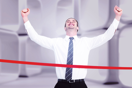 caucasian race: Happy businessman crossing the finish line against white abstract room