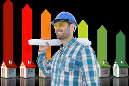 representing: Smiling architect looking away while holding blueprint against seven 3d homes representing energy efficiency