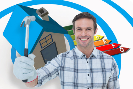 ratings: Happy handyman holding hammer against energy ratings chart coming from 3d house