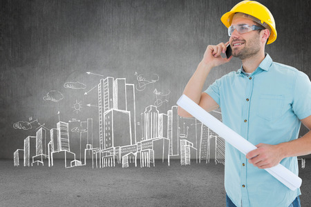 Male architect with blueprint talking on mobile phone against hand drawn city plan photo