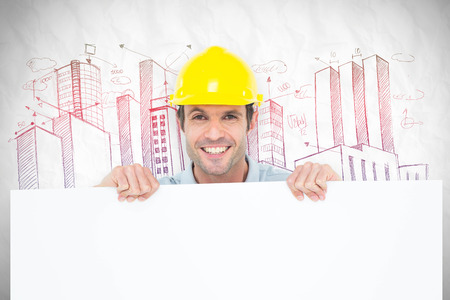 bill board: Architect with bill board over white background against crumpled white page Stock Photo