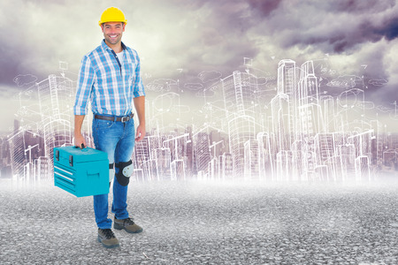 Full length portrait of repairman with toolbox against black road photo