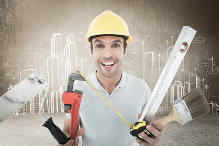 Portrait of happy worker holding various equipment against hand drawn city plan photo
