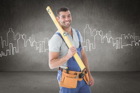 spirit level: Worker holding spirit level against hand drawn city plan