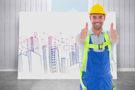 safety gear: Builder in safety gear against composite image of white card