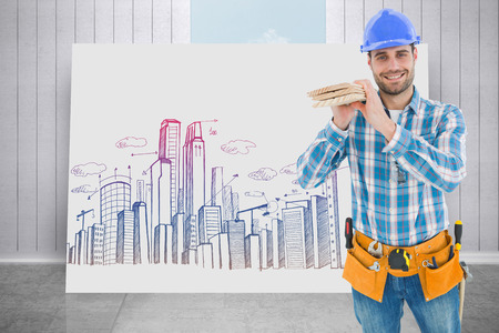 Happy carpenter carrying wooden planks against composite image of white card photo