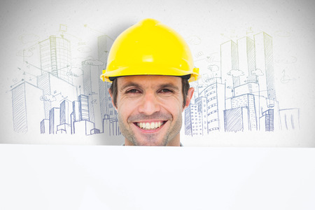 bill board: Happy architect with bill board over white background against grey Stock Photo