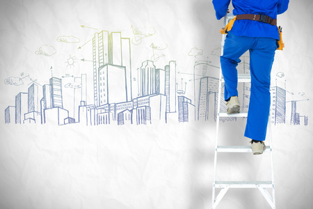 step ladder: Low section of carpenter climbing step ladder against crumpled white page Stock Photo