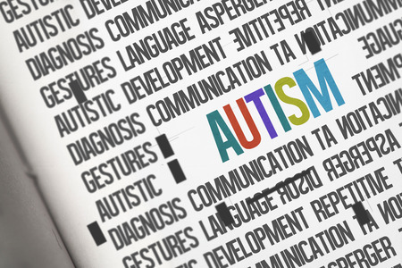 literate: The word autism against open book Stock Photo