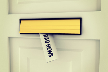 bad news: The word bad news against letter through post box Stock Photo